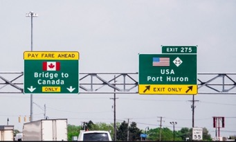 signs at the USA Canada border crossing at Port Huron