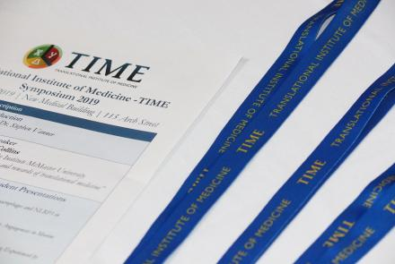 Image of TIME Symposium agenda and lanyards