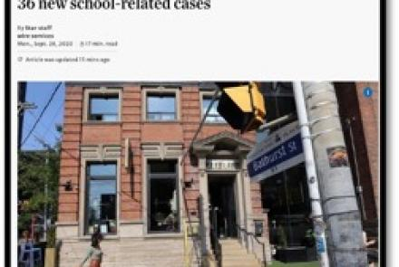 news article stating 700 case in Ontario shows building and street sign