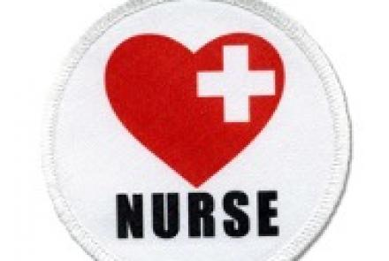 white patch with red heart and the word nurse under it