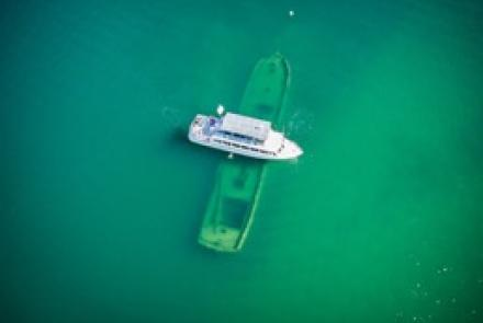Boat floating over a sunken boat
